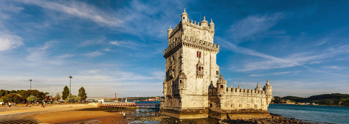 Beautiful ancient Belem tower panoramic view at sunset Lisbon Portugal
