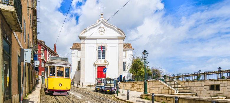View of Santa Luzia Church and vintage tram in Lisbon, Portugal