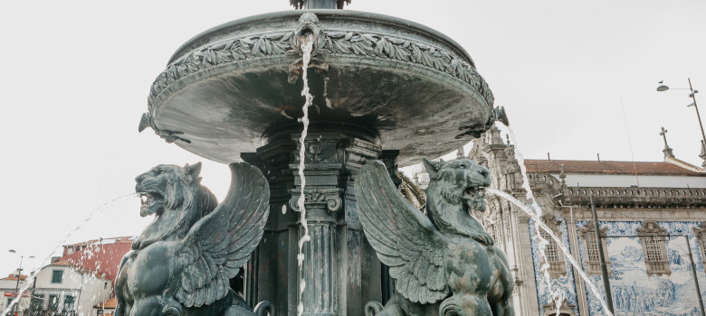 Ancient Winged Lion Fountain In The Town Square In Porto, Portug